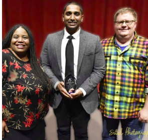 WASI MOHAMED (CENTER) AFTER RECEIVING THE NEWPERSON OF THE YEAR AWARD PRESENTED BY BOARD MEMBERS M. SHERNELL SMITH (L) AND ROB CONROY (PRESIDENT, R)